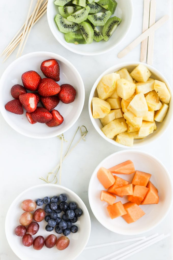 Fruit Cut Up in Bowls with Kebabs Sticks for Skewering
