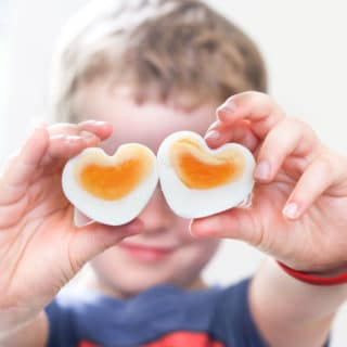 Child Holding Heart Shaped Eggs