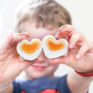 Child Holding Heart Shaped Eggs