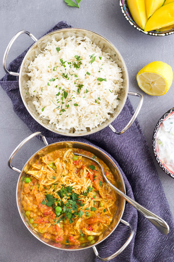 Slow Cooker Chicken Curry Served with Rice and Cucumber Dip