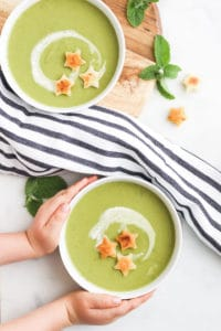 Child Grabbing Plate of Pea and Mint Soup