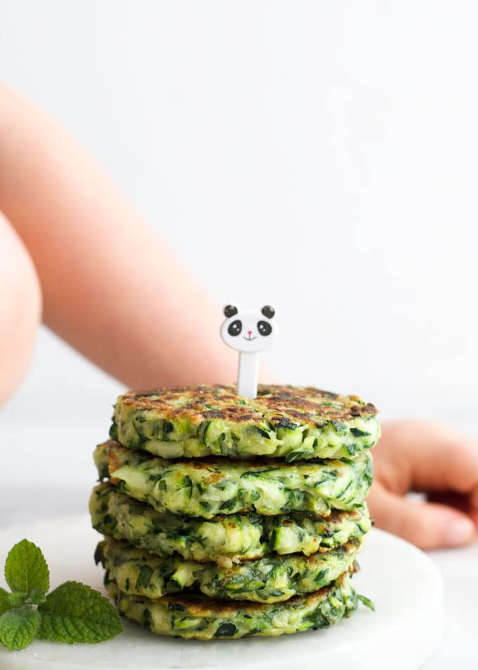 Stack of Zucchini Fritters with Kid Fork Pic on Top
