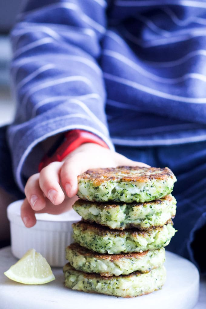 Child Grabbing Broccoli Fritter from Stack
