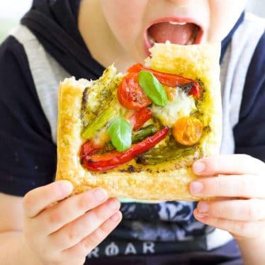 Child Eating Roast Vegetable Puff Pastry Tart