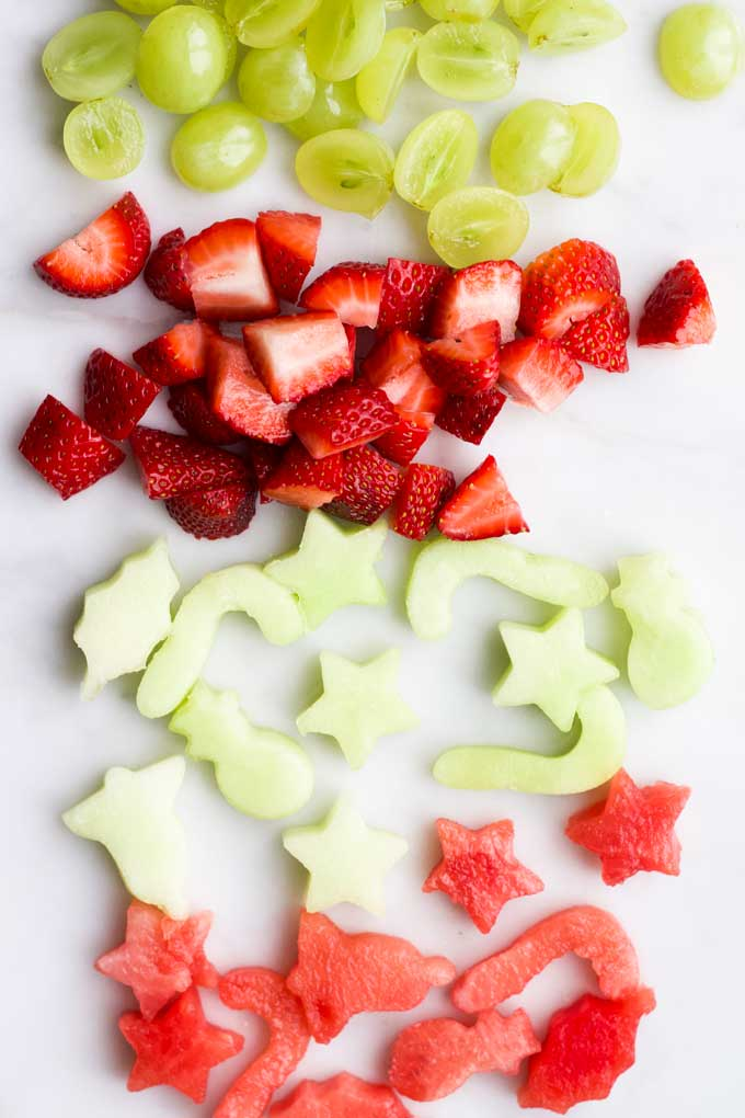 Selection of Red and Green Fruits Cut up for Fruit Salad