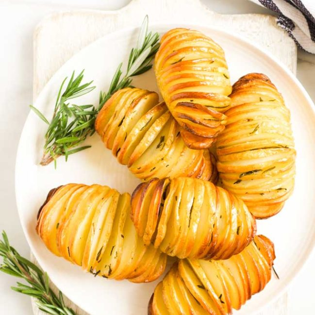 Hasselback Potatoes on Plate with Sprigs of Rosemary