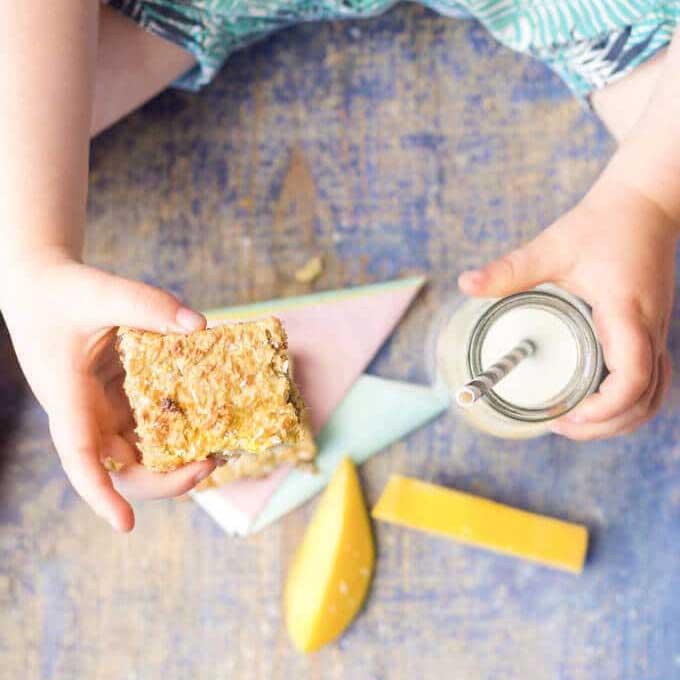 Child HoldingCoconut mango Squares