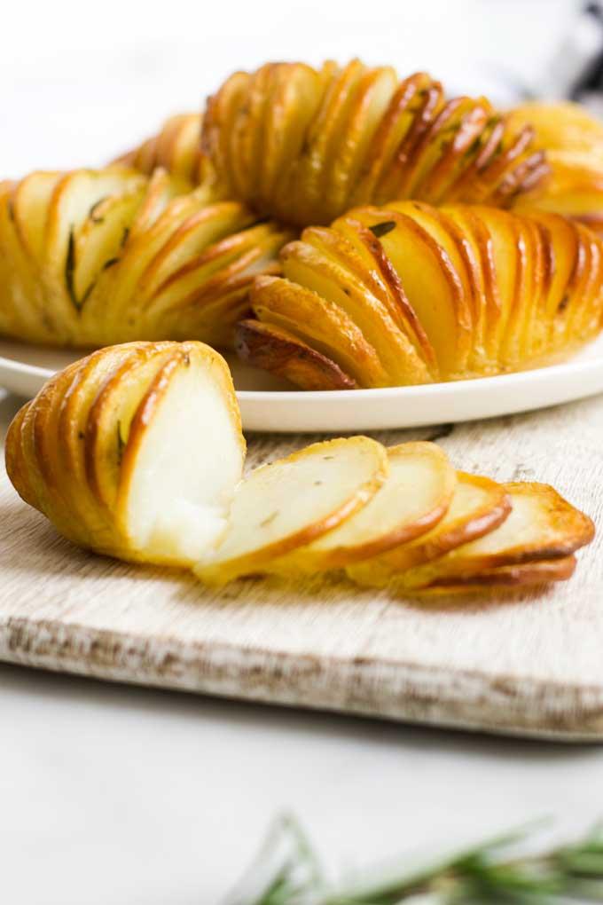 Hasselback Potatoes Sliced on Board