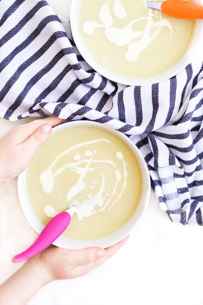 Child Grabbing a Bowl of Leek and Potato Soup