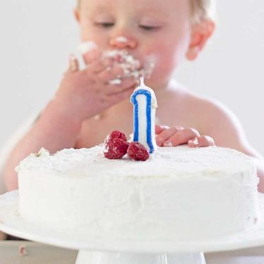 Baby Eating Healthy First Birthday Cake