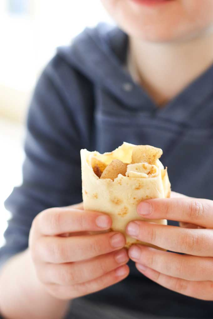 Child Eating an Apple Crepe