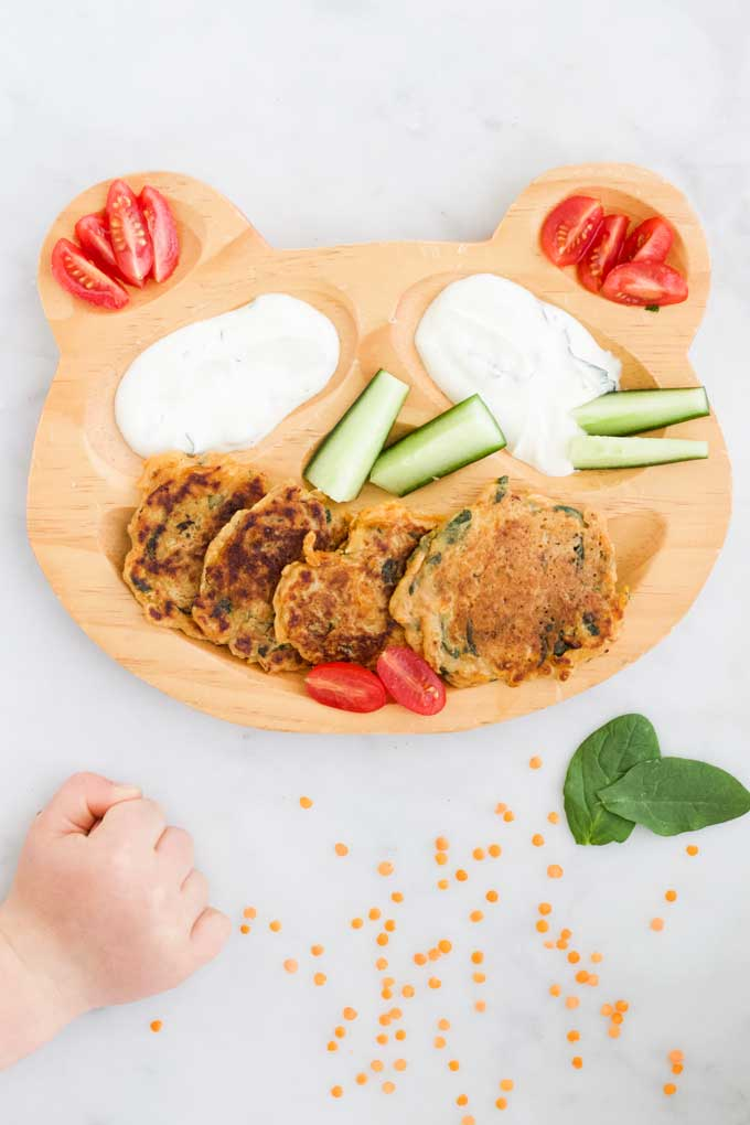 Lentil Pancakes on Kids Plate Served with Veggies and Yoghurt Dip