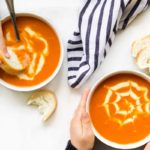 Top Down View of Two Children Eating Bowls of Tomato Soup