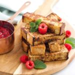 Stack of Eggy Bread Fingers (French Bread Fingers) with Side of Fruit Compote