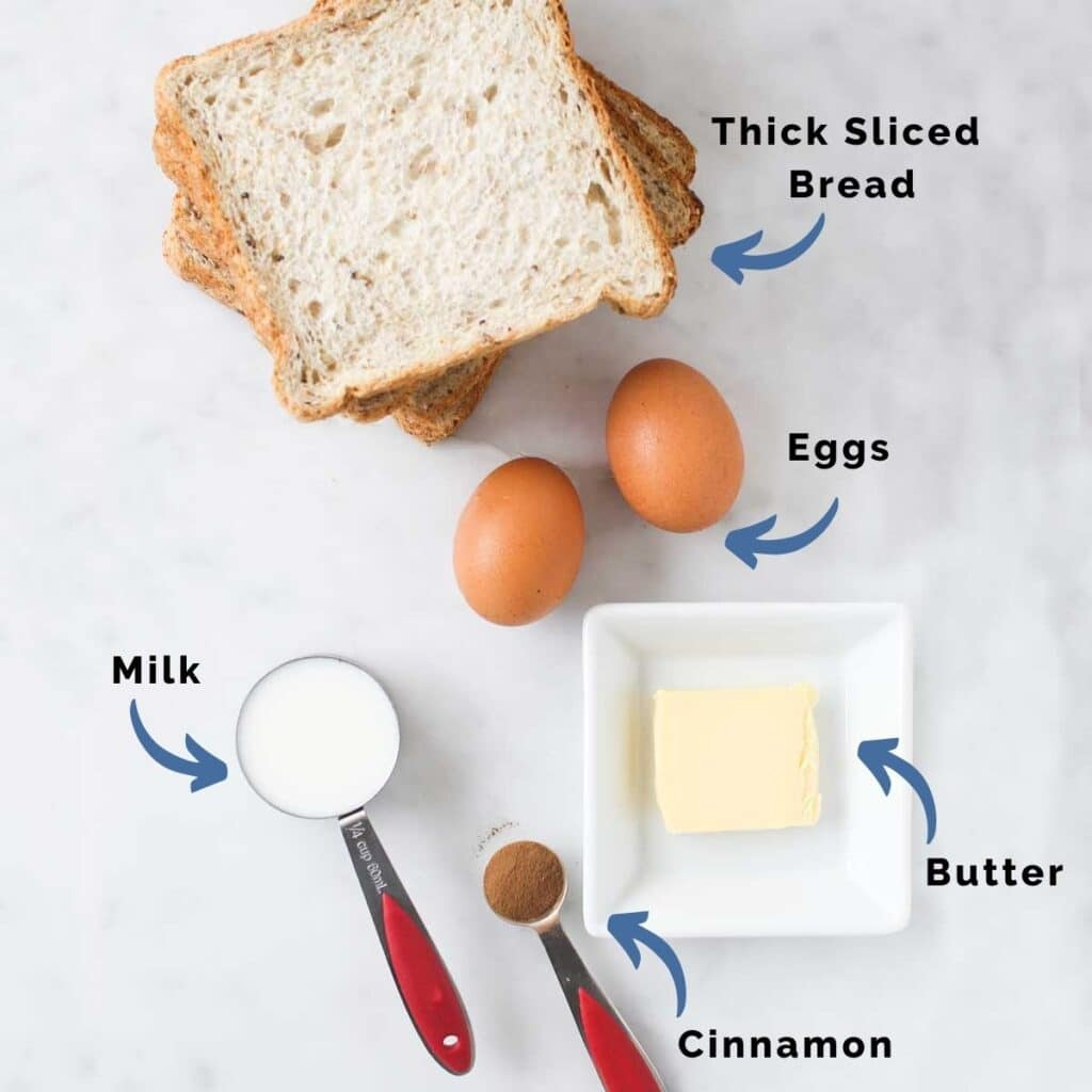 Top Down View of Eggy Bread Ingredients (Bread, Eggs, Milk, Cinnamon and Butter