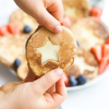 Child Holding Gingerbread Pancake with Apple Star Insert
