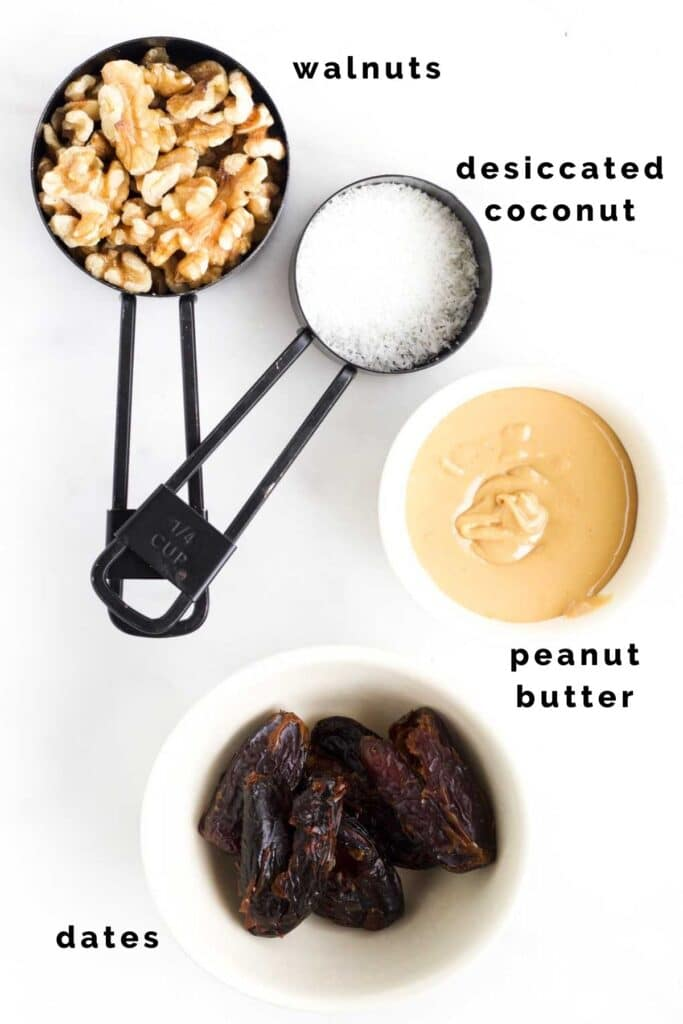 Flat Lay of the Ingredients Needed to Make Nut Balls (Walnuts, Coconut, Peanut Butter and Dates)