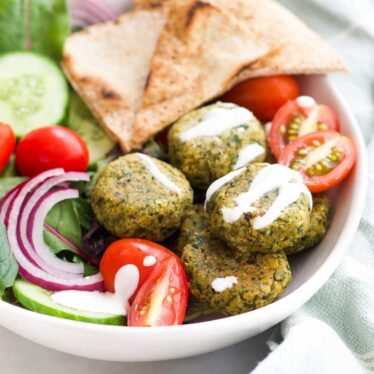 Baked Falafel in Bowl with Salad and Pita Triangles.