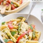 Bowl of Roasted Vegetable Pasta with Grated Parmesan on Top