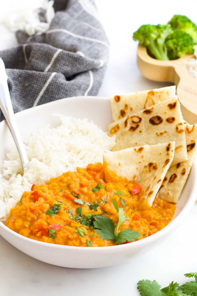 Lentil Curry in Bowl with Rice and Roti Bread