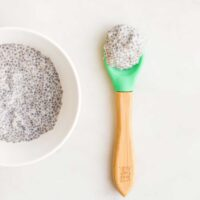 Top Down View of Chia Seed Gel in a Small Bowl With Spoonful Sitting Next to It