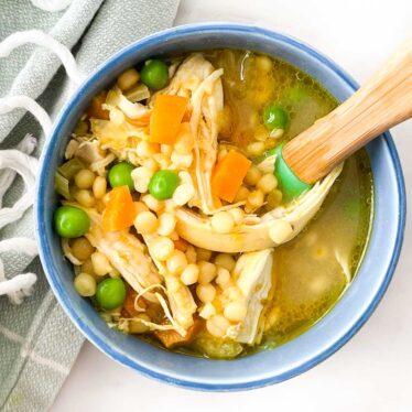 Top Down Shot of Chicken Soup in Toddler Bowl