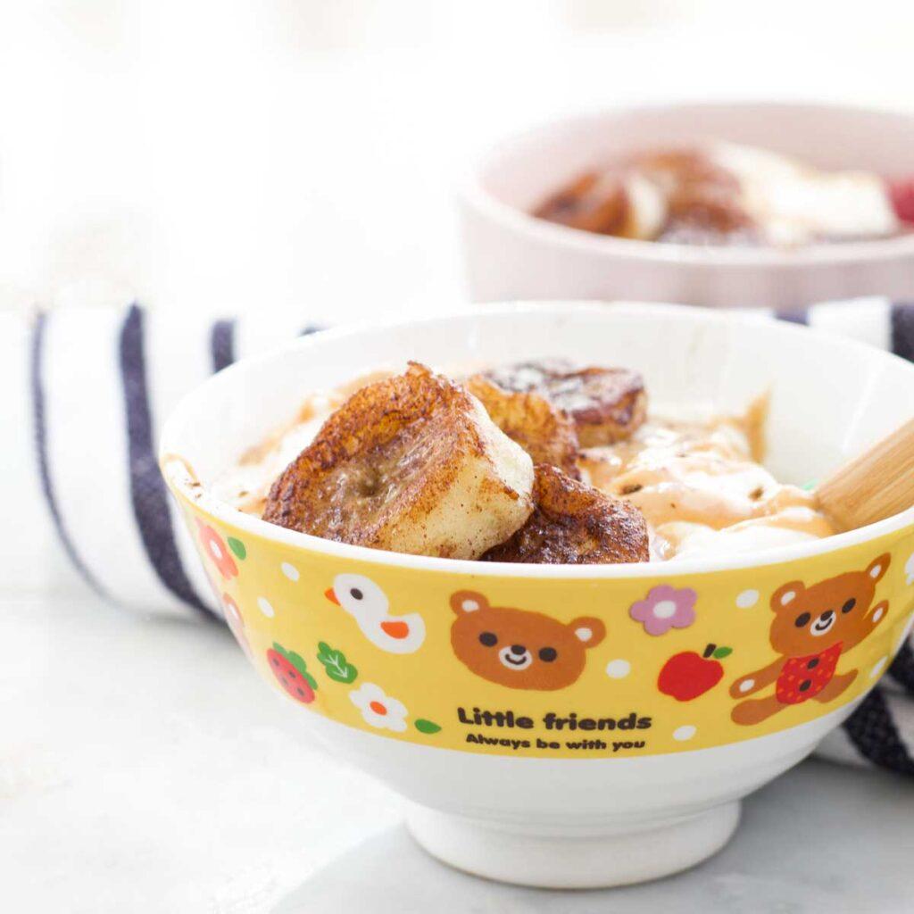 Kids Bowl of Yoghurt Topped with Pan fried Bananas