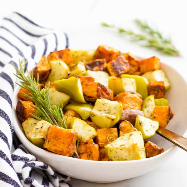 Roasted Sweet Potato and Apple Chunks in Serving Bowl with Sprig of Rosemary