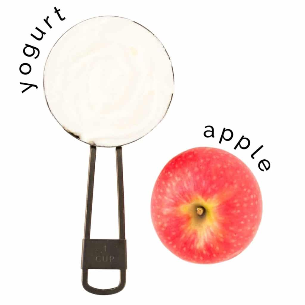 Flat Lay of Yogurt in Measuring Cup and an Apple