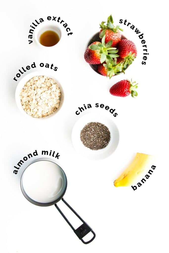 Flat Lay Shot of Ingredients Needed to Make Strawberry Overnight Oats (Labelled)