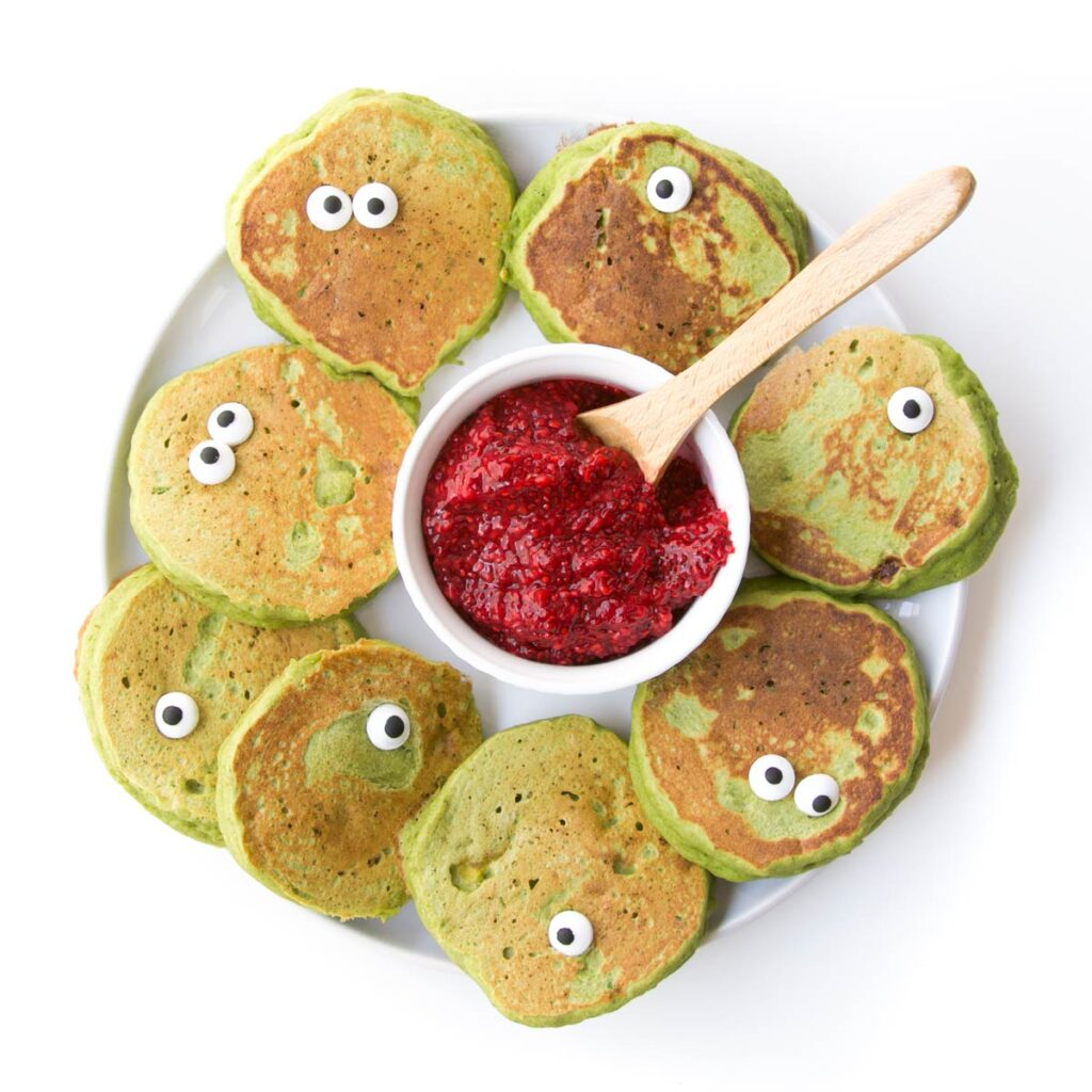 """Green """"Monster"""" Pancakes with Candy Eyes and Side Chia Jam"""